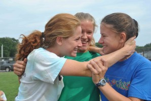 Seniors Bridget Maloney, Courtney Ackerman, and Claire McCain goof around during cross-country practice. (Horner)
